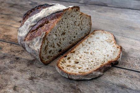 Foto für Sliced bread on a wooden table. - Lizenzfreies Bild
