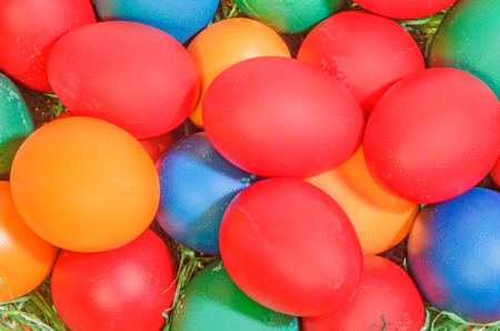 Many colored painted easter eggs, close up background.