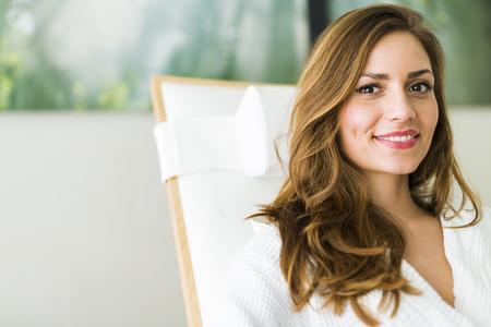 Foto de Portrait of a beautiful young  healthy woman relaxing in a robe - Imagen libre de derechos