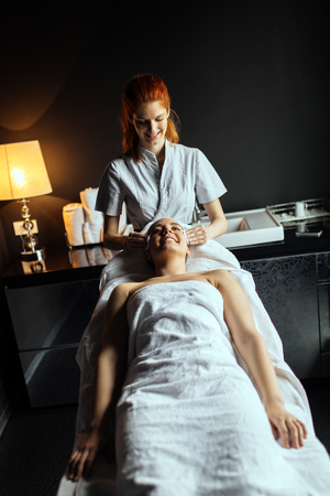 Massaging of a beatufil woman who desires professional treatment