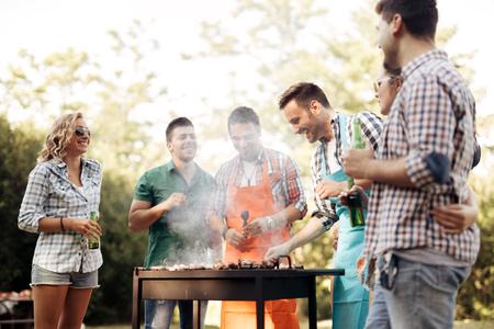 Foto de Friends camping and having a barbecue in nature - Imagen libre de derechos