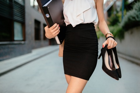 Businesswoman finished working going home