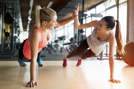 Foto de Beautiful women working out in gym together - Imagen libre de derechos