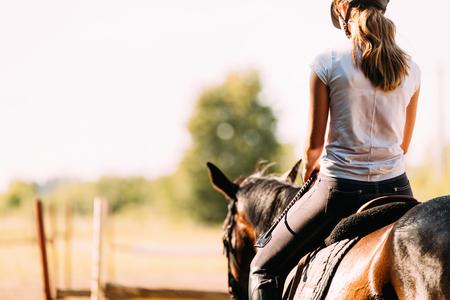 Photo pour Picture of young pretty girl riding horse - image libre de droit