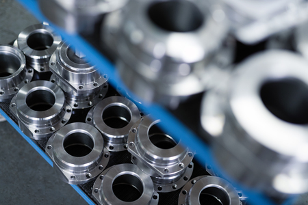 Photo pour Industrial background from metal parts produced in metal industry - image libre de droit