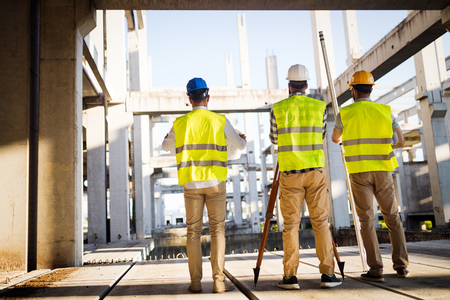 Photo for Team of construction engineers working on building site - Royalty Free Image