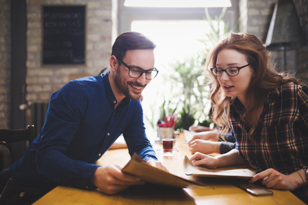 Couple eating out and dating in restaurant