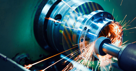 sparks flying while machine griding and finishing metal