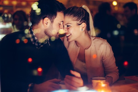 Foto per Romantic couple dating in pub at night - Immagine Royalty Free