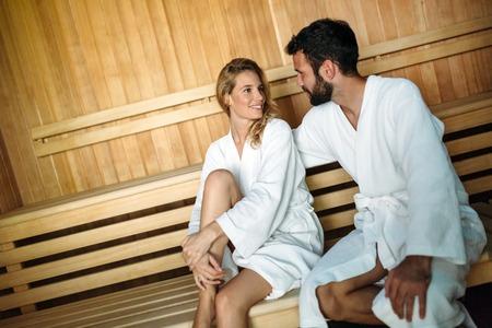 Photo pour Attractive happy couple relaxing in spa center - image libre de droit