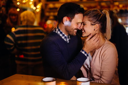 Photo pour Romantic couple dating in pub at night - image libre de droit