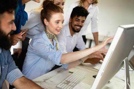 Foto de Successful happy group of people learning software engineering and business during presentation - Imagen libre de derechos
