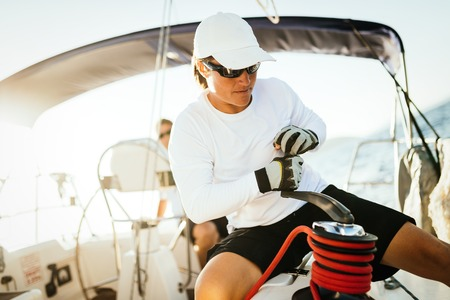 Photo for Attractive strong woman sailing with her boat - Royalty Free Image