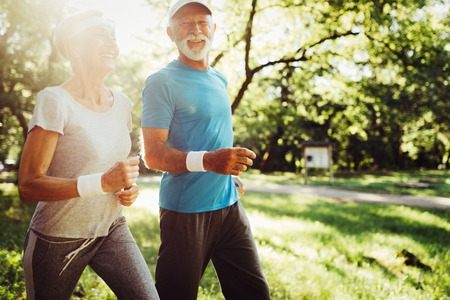 Photo pour Happy senior people jogging to stay helathy and lose weight - image libre de droit