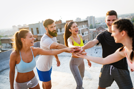 Photo for Group of happy fit friends exercising outdoor in city - Royalty Free Image