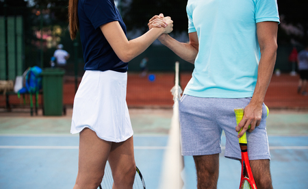 Photo for Group of tennis player handshaking after playing a tennis match. Fairplay, sport concept. - Royalty Free Image