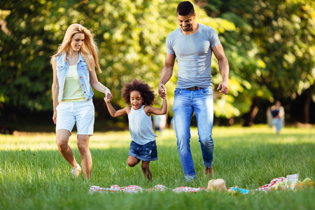 Photo pour Happy young couple spending time with their daughter - image libre de droit
