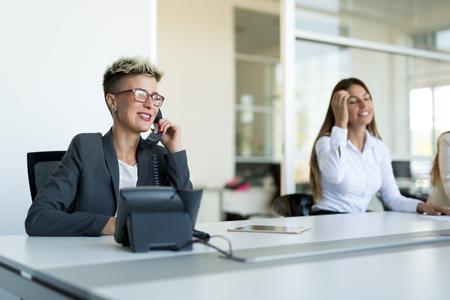Photo pour Portrait of businesswoman working on computer in office - image libre de droit