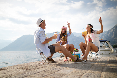 Photo for Group of friends enjoying summer vacation. Summer, holidays, vacation and happiness concept - Royalty Free Image