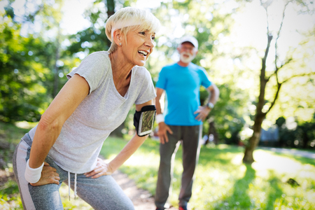 Photo pour Mature couple jogging and running outdoors in nature - image libre de droit