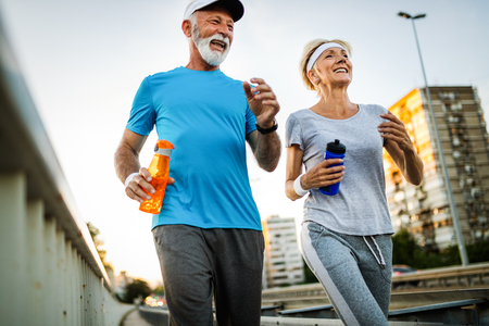 Foto für Fitness, sport, people, exercising and lifestyle concept - senior couple running - Lizenzfreies Bild