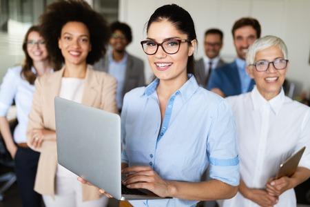 Photo pour Portrait of business team posing in office - image libre de droit