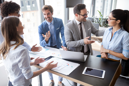 Foto de Group of successful business people at work in office - Imagen libre de derechos