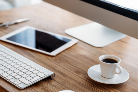 Photo for Office desk with computer, tablet and cup of coffee - Royalty Free Image
