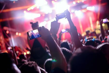 Foto de Portrait of happy crowd enjoying at music festival - Imagen libre de derechos