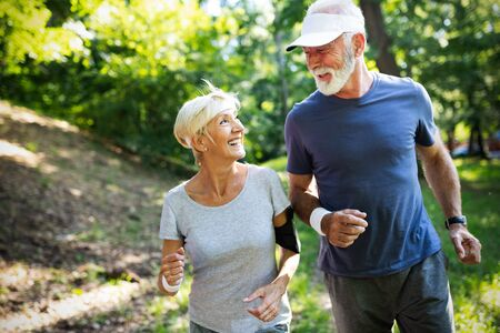 Photo for Mature couple jogging and running outdoors in nature - Royalty Free Image