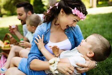 Foto per Young family with children having fun in nature - Immagine Royalty Free