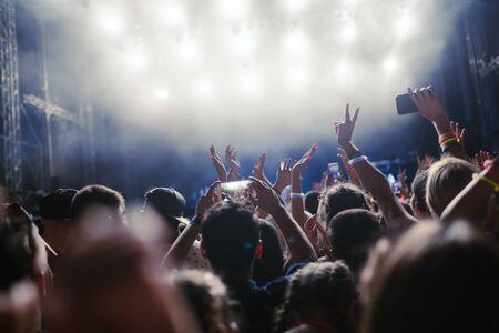 Photo pour Portrait of happy crowd enjoying at music festival - image libre de droit