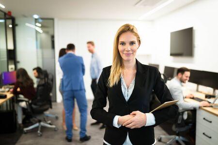 Foto de Portrait of successful beautiful businesswoman in office - Imagen libre de derechos