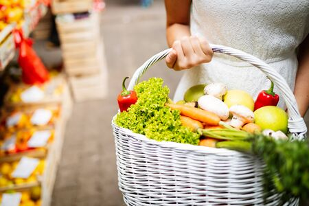 Photo for Young woman shopping healthy food on the market - Royalty Free Image