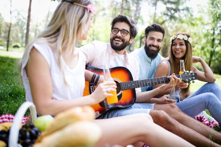 Photo for Happy group of friends relaxing and having fun on picnic in nature - Royalty Free Image