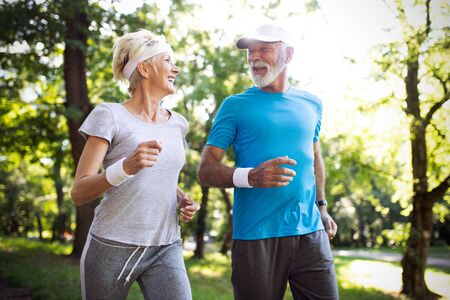 Foto de Happy mature people couple exercising for healthy life - Imagen libre de derechos