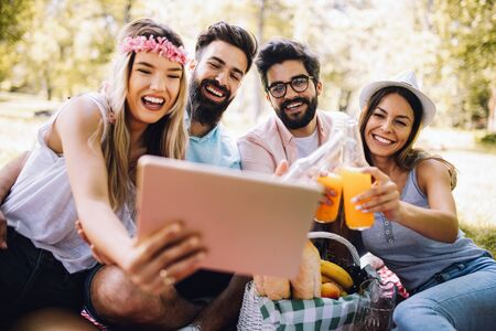 Photo for Group of young people taking a selfie outdoors, having fun - Royalty Free Image