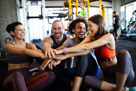 Photo for Happy fit friends exercising, working out in gym to stay healthy together - Royalty Free Image
