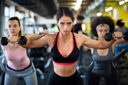 Photo for Fit sporty women exercising and training at fitness club - Royalty Free Image