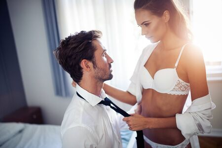 Photo for Sexy woman and man playing domination games in bed - Royalty Free Image