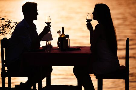 Photo for Couple sharing romantic sunset dinner on tropical resort - Royalty Free Image