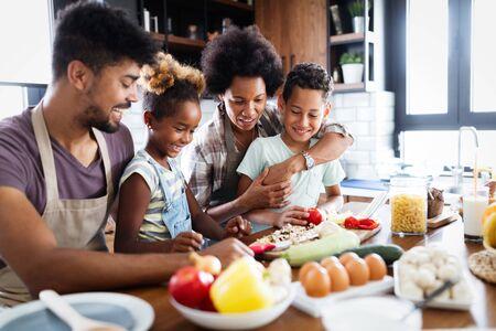 Photo pour Happy family preparing together food in the kitchen - image libre de droit