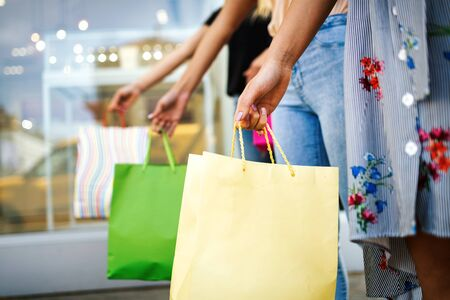 Photo for Sale and travel, happy people concept. Women with shopping bags in the ctiy - Royalty Free Image