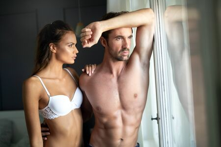Photo pour Beautiful woman and handsome muscular man close to each other in erotic pose. - image libre de droit