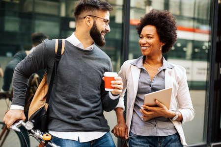 Photo pour Happy business people, students having fun, smiling, talking in the city - image libre de droit