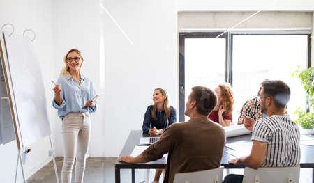 Foto de Entrepreneurs desginers architects business people conference in office - Imagen libre de derechos