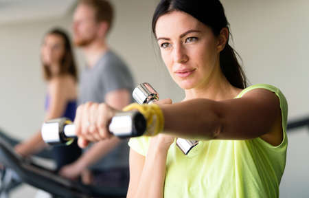 Photo for Happy fit fitness girl exercising indoor in fitness center. - Royalty Free Image