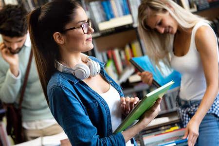 Photo pour Happy young university students friends studying with books at university - image libre de droit