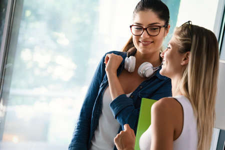 Photo pour Happy friends with books having fun while studying. Friendship, study, education concepts. - image libre de droit