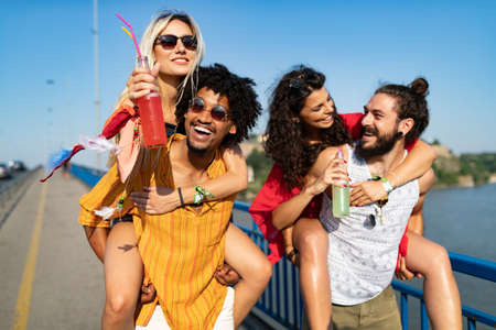 Photo for Group of happy friends people having fun together outdoors - Royalty Free Image